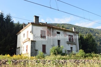 Dilapidated old house in the countryside with a project for the realization of several residential units in Kiens in the Puster Valley for sale